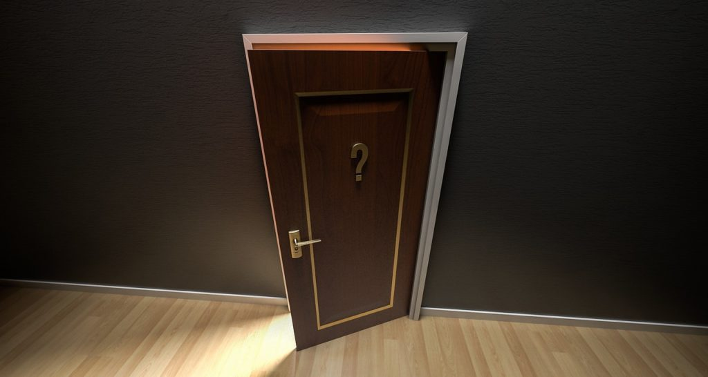 Open door with question mark